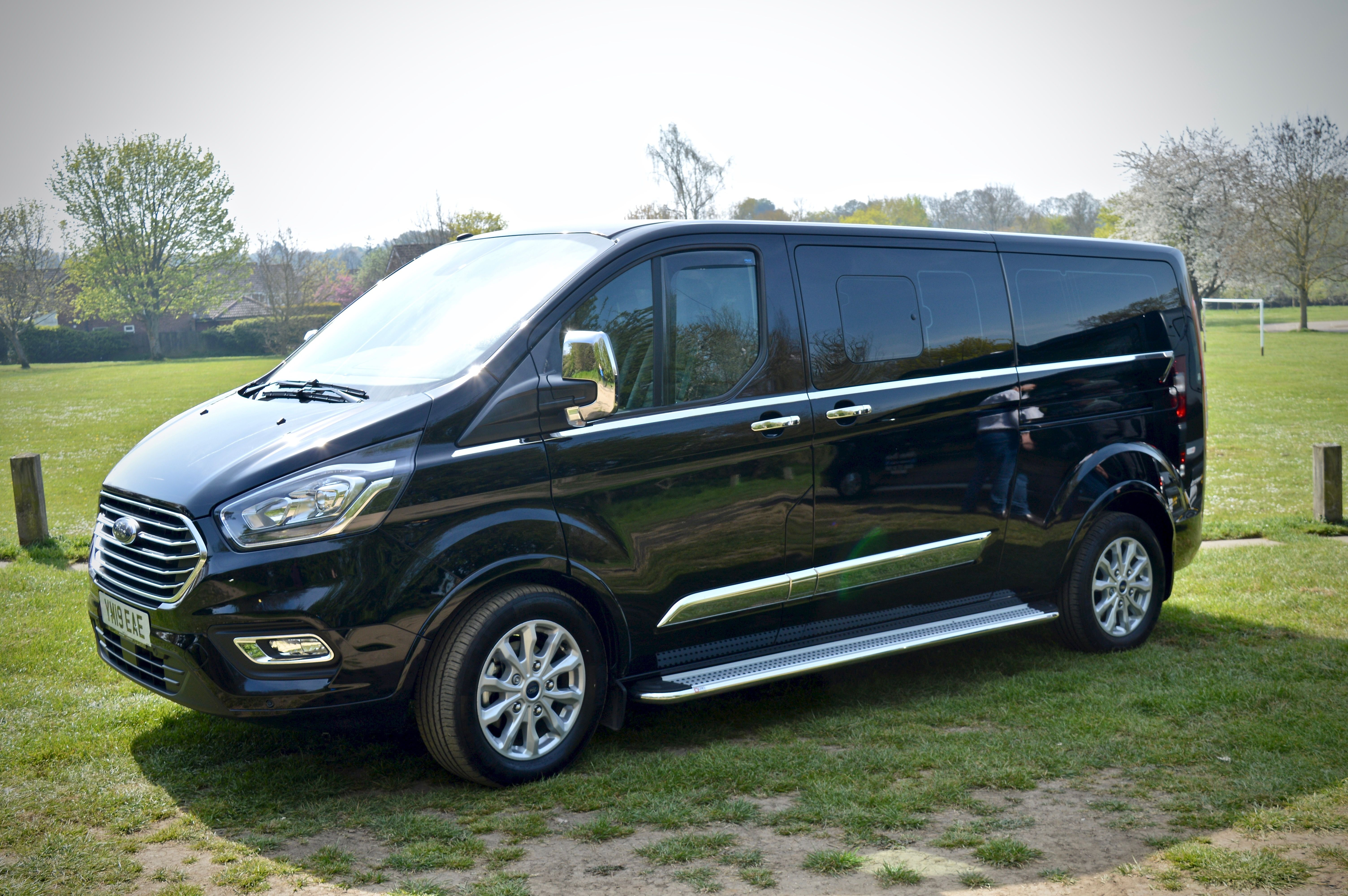 Outside view of the ford custom royale 8 seater private hire taxi