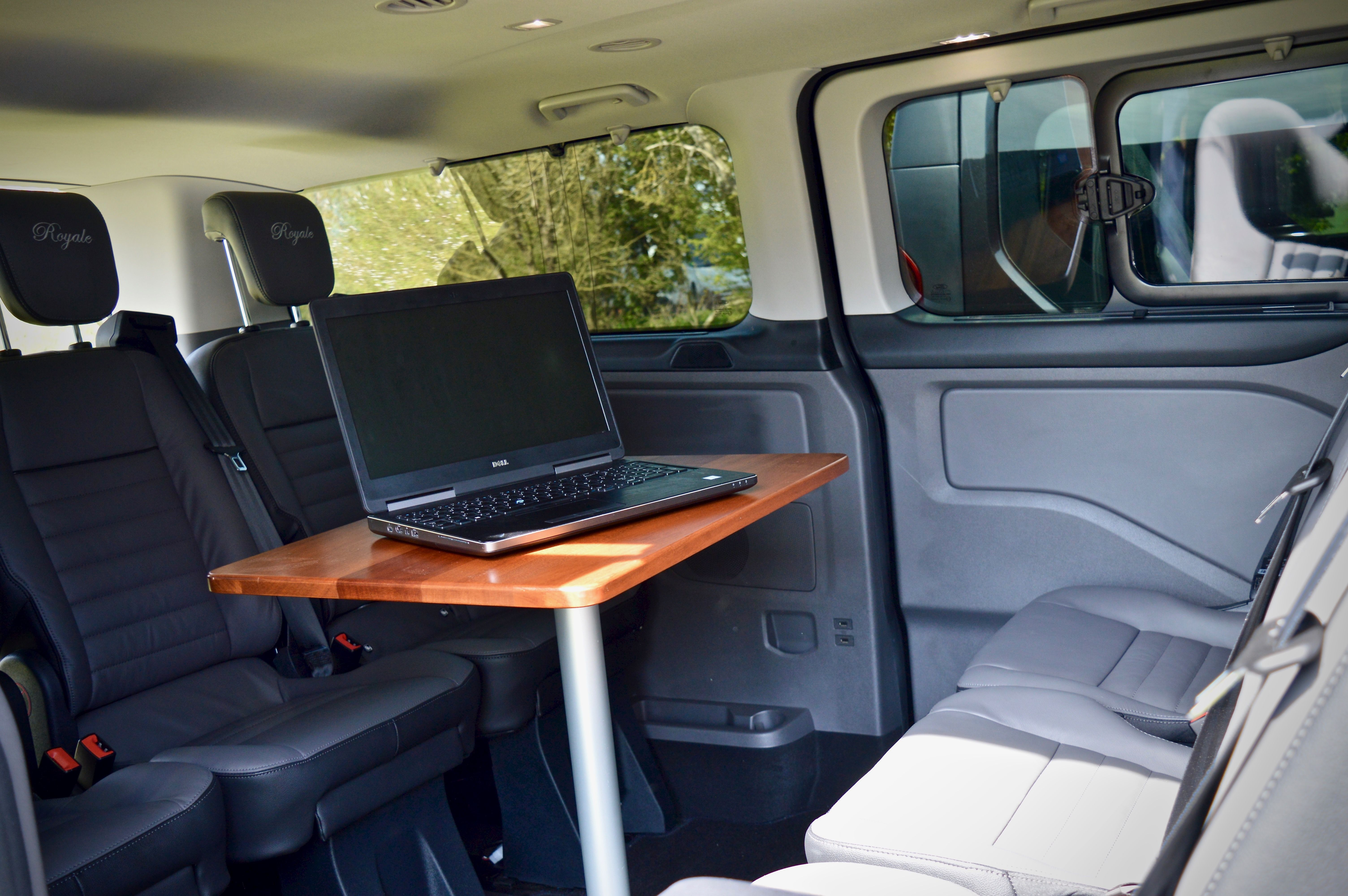 A possible use of the table within the taxis, can be used for business use including laptops
