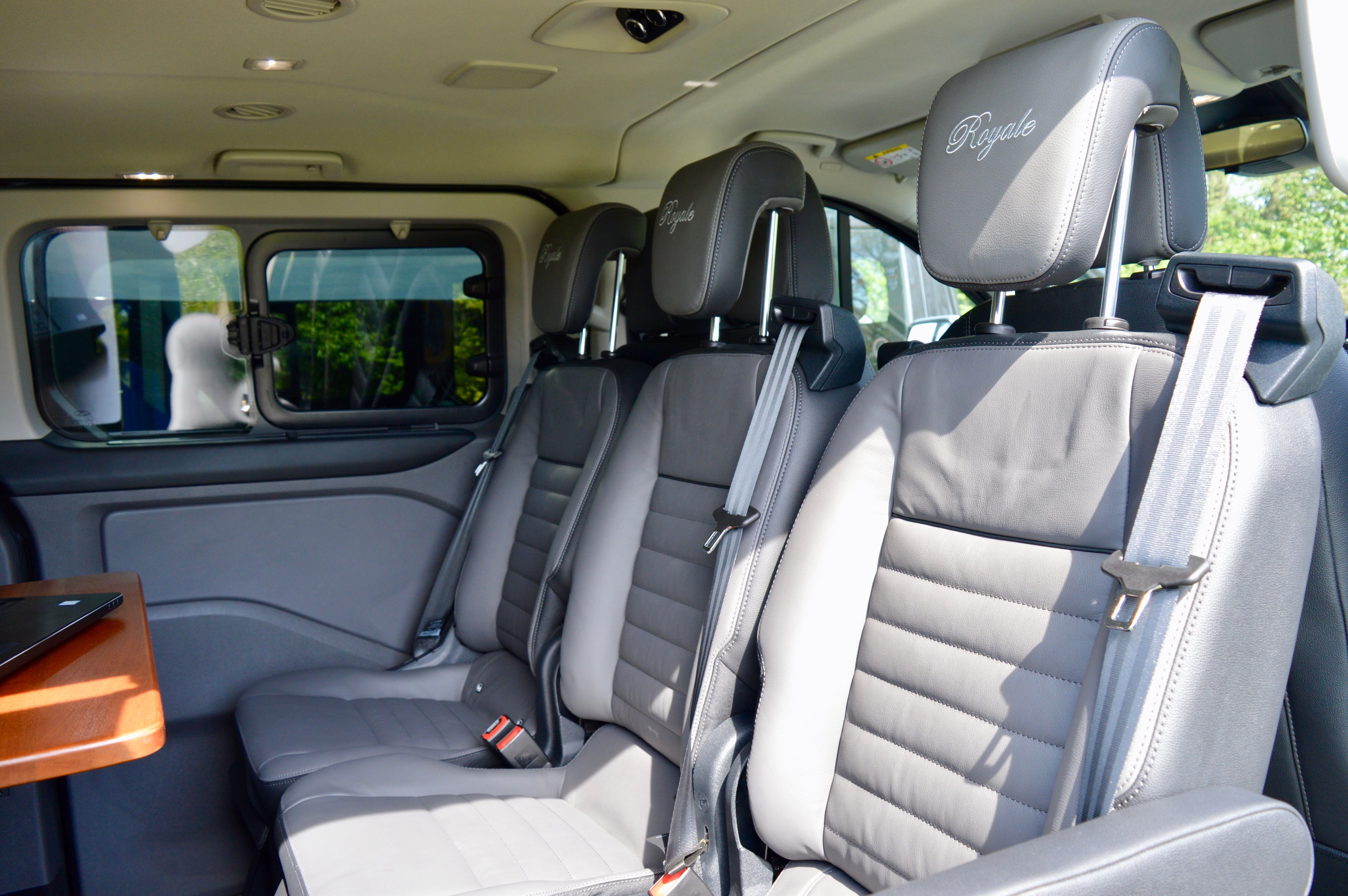 Another view of the leather seats within the vehicle showing how they are positioned next to the table