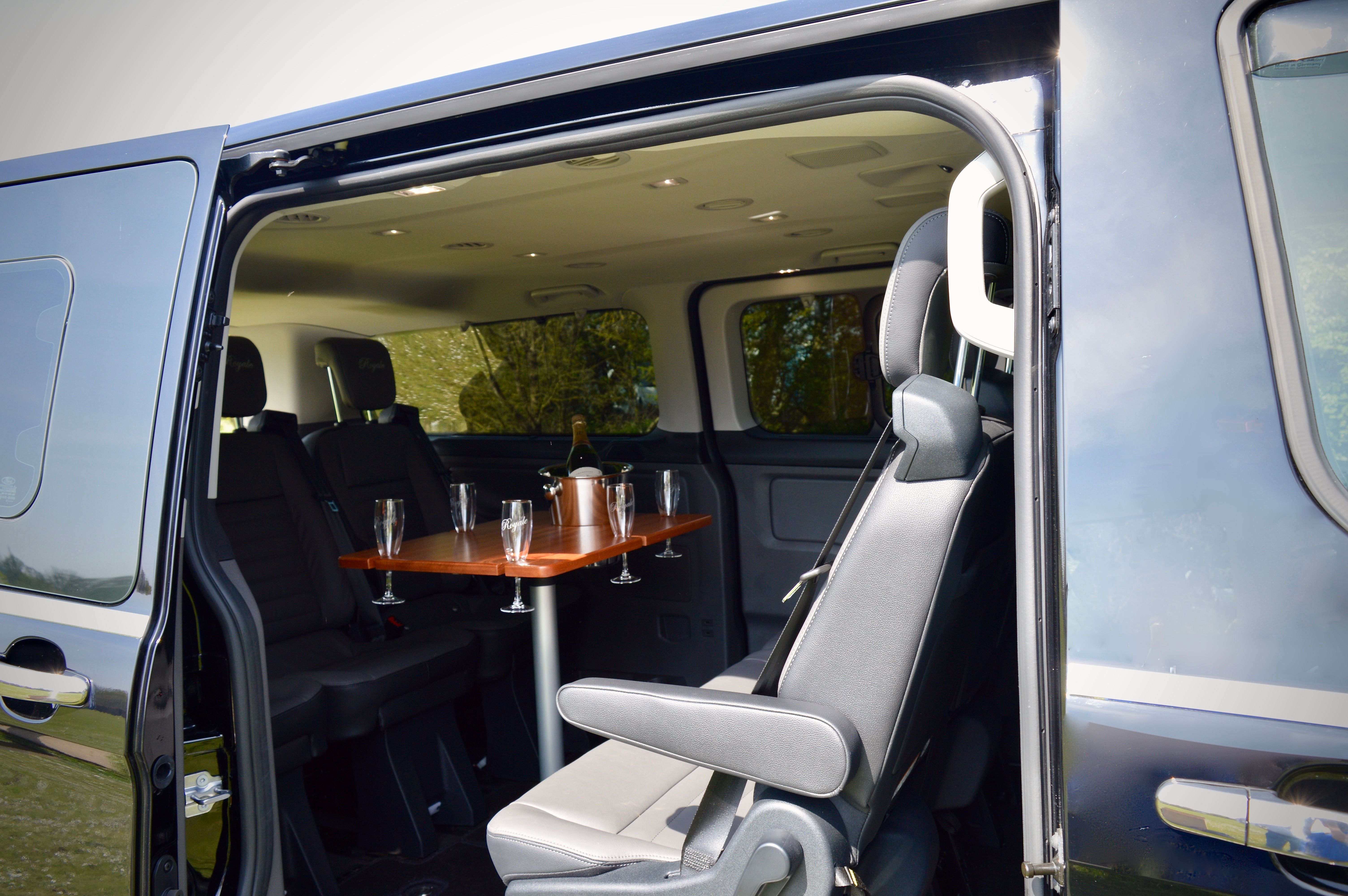 View from outside the 8 seater vehicle, showing the champagne table