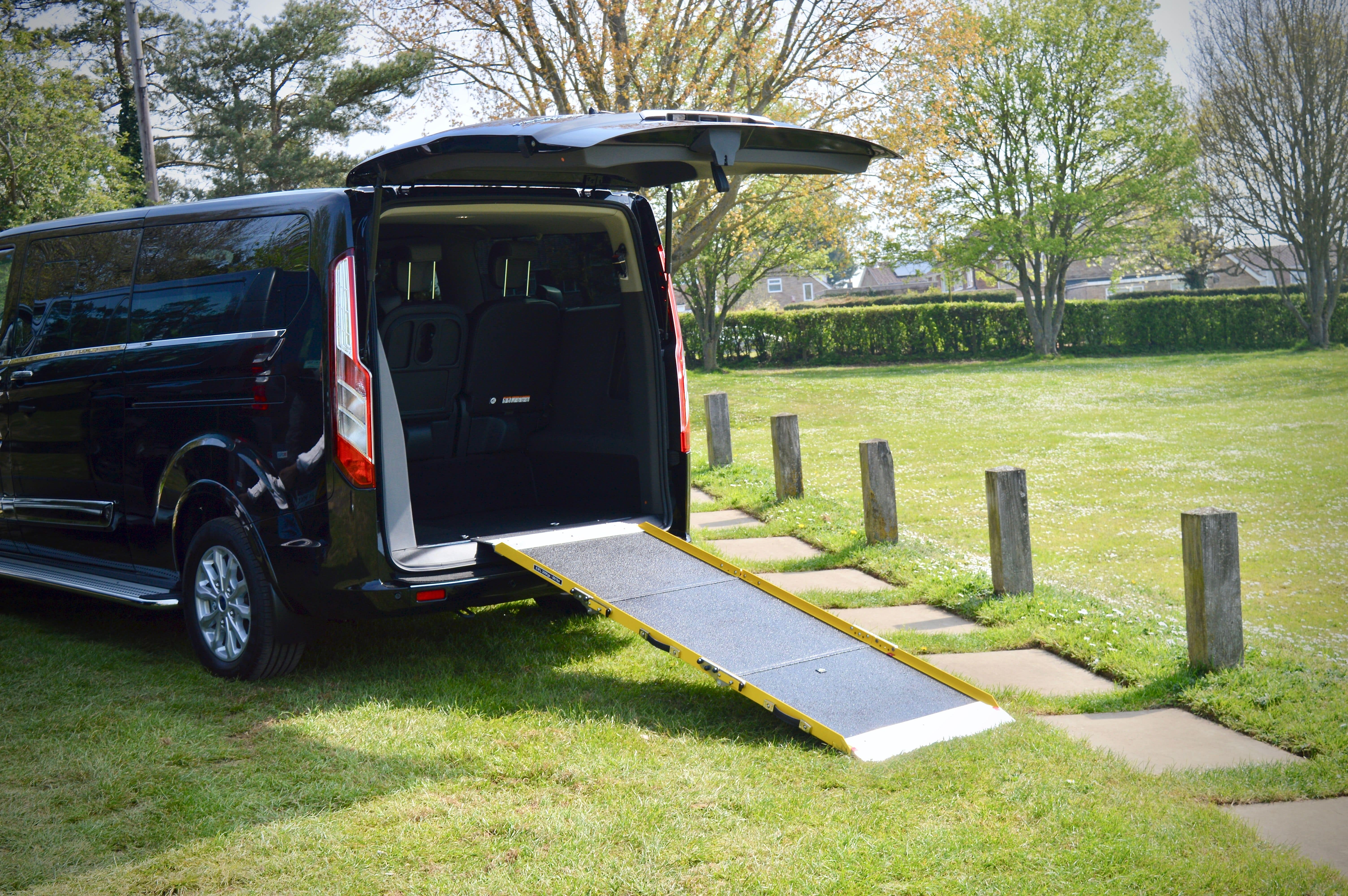 The ramp for wheelchair passengers attaches to the rear end of the vehicle