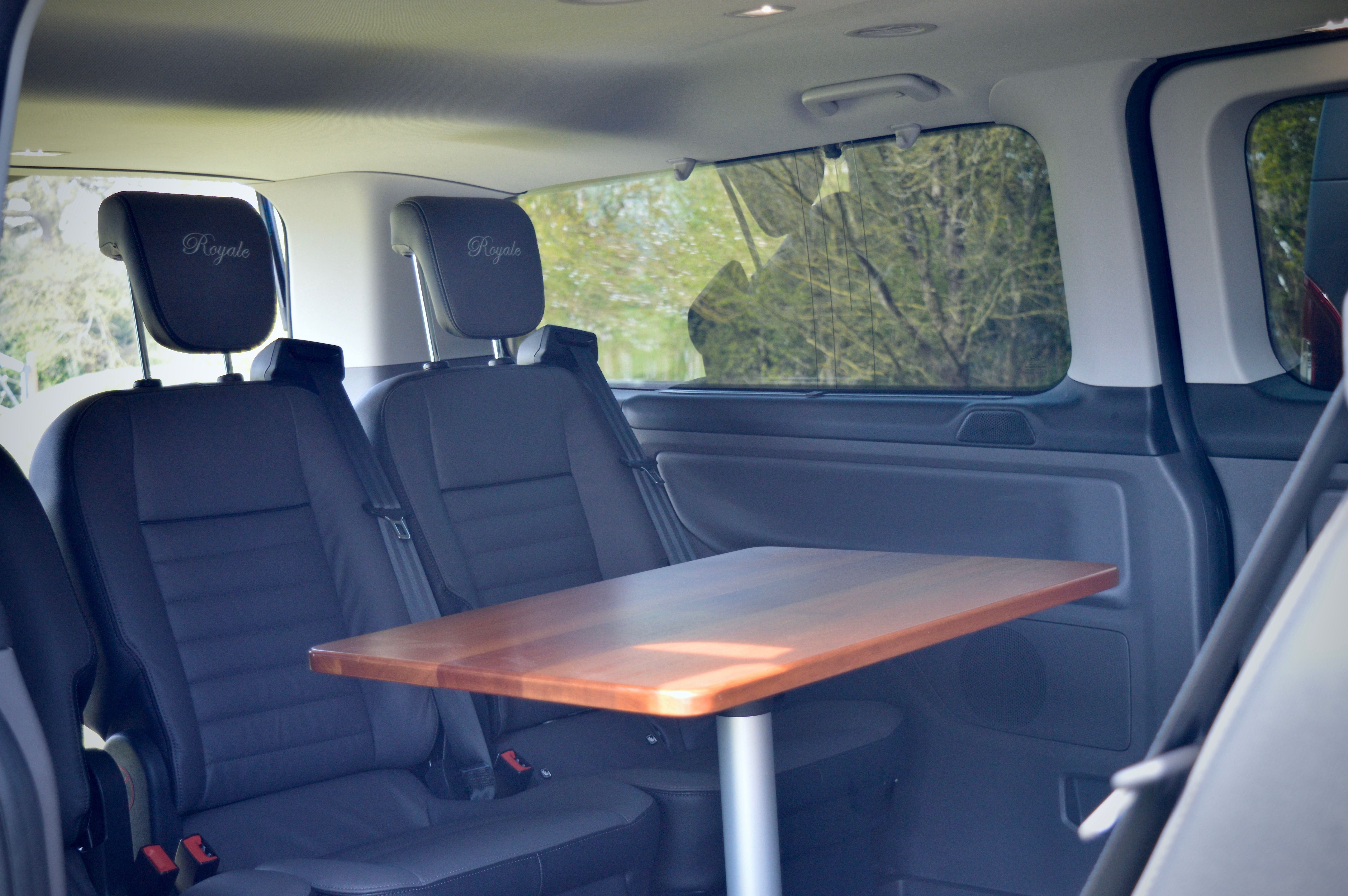 The inside view of the taxi showing the leather seats surrounding the table
