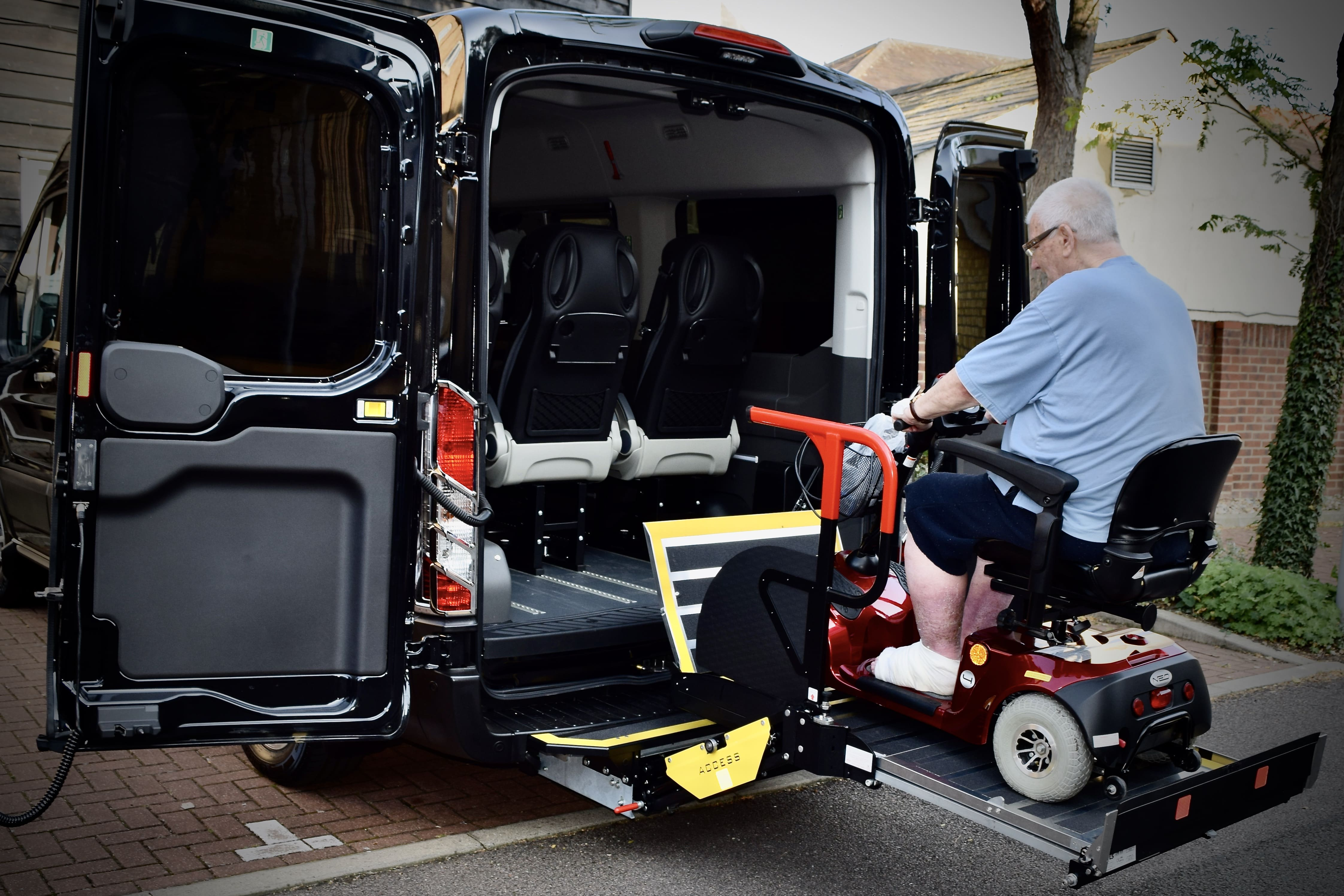Showing the operation of the wheelchair access with tail gate
