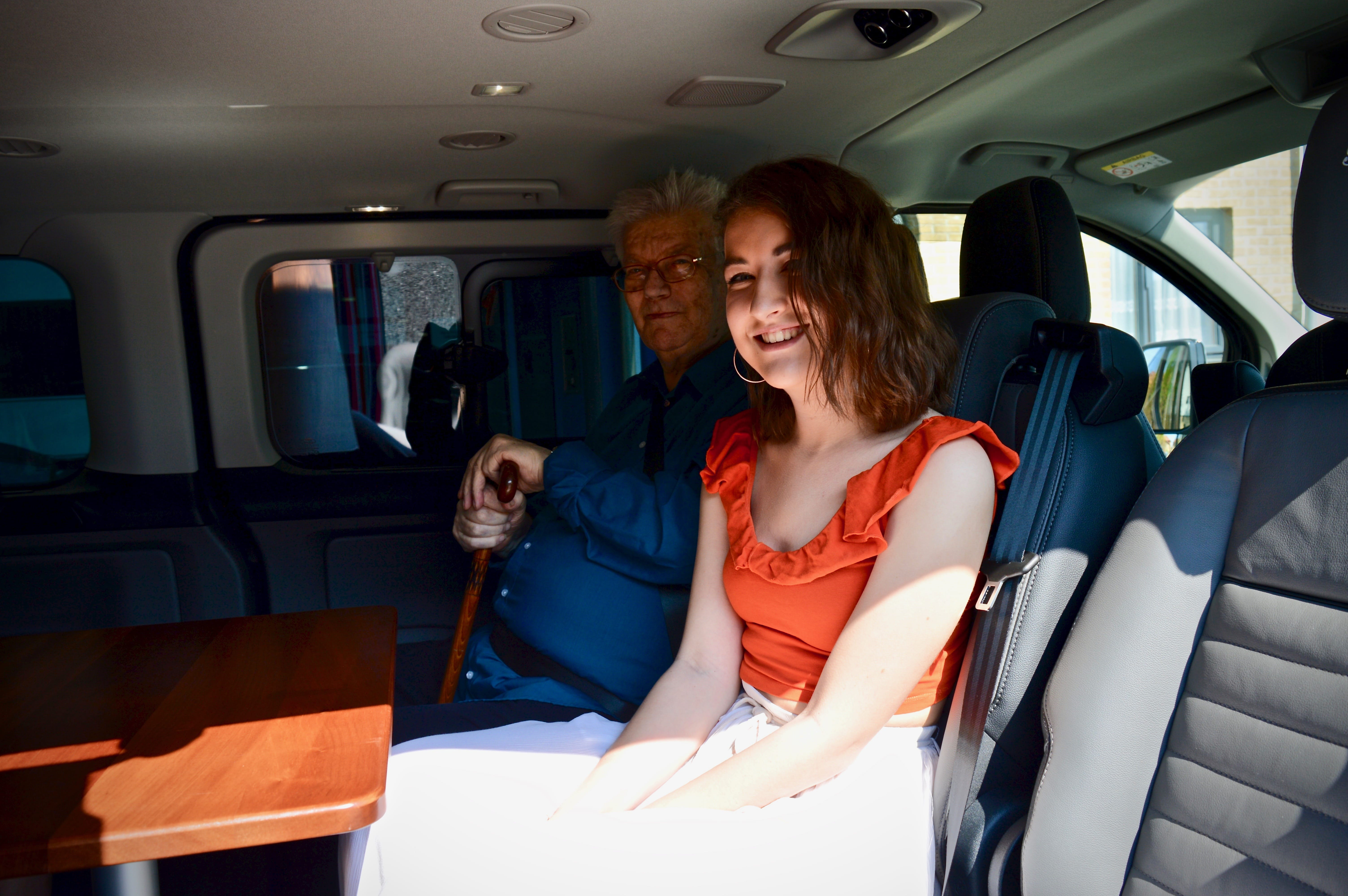 Passengers sitting in the 8 seater wheelchair accessible vehicle